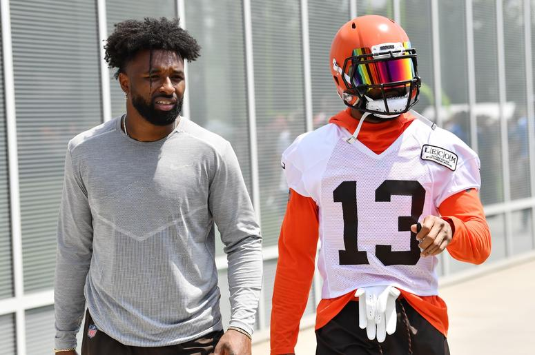 Cleveland Browns wide receiver Jarvis Landry (left) and wide receiver Odell Beckham (13) leave the field after training camp at the Cleveland Browns Training Complex.
