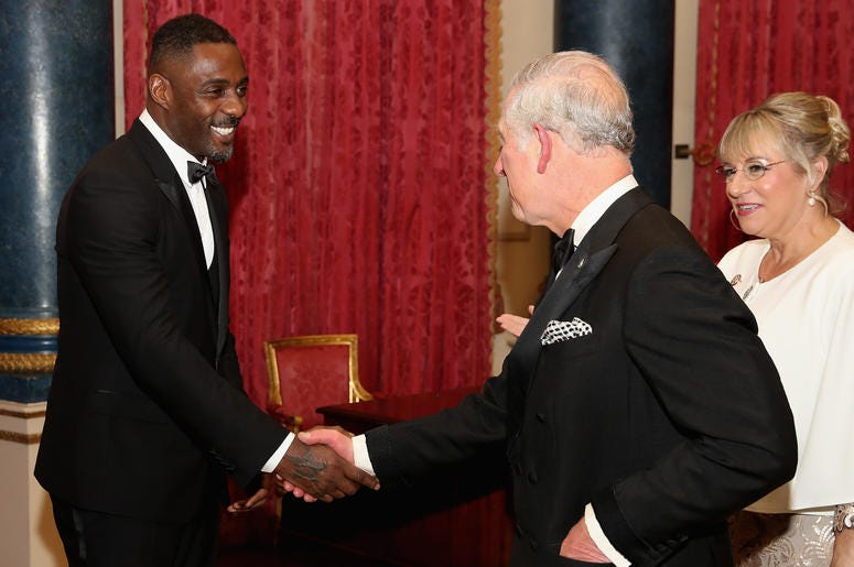The Prince of Wales meets Idris Elba (left) during the Prince's Trust One Million Young Lives Dinner, at Buckingham Palace in London