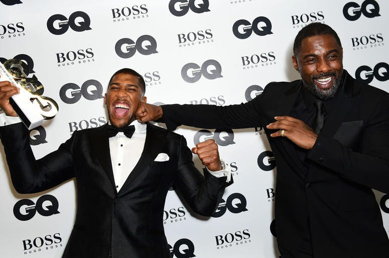 Review of the Year 2017: September: Anthony Joshua (left) with his Best Sportsman award poses with Idris Elba during the GQ Men of the Year Awards 2017 held at the Tate Modern, London.