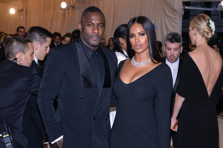 Idris Elba and Sabrina Dhowre walking on the red carpet at The Metropolitan Museum of Art Costume Institute Benefit celebrating the opening of Heavenly Bodies : Fashion and the Catholic Imagination held at The Metropolitan Museum of Art in New York, NY, o