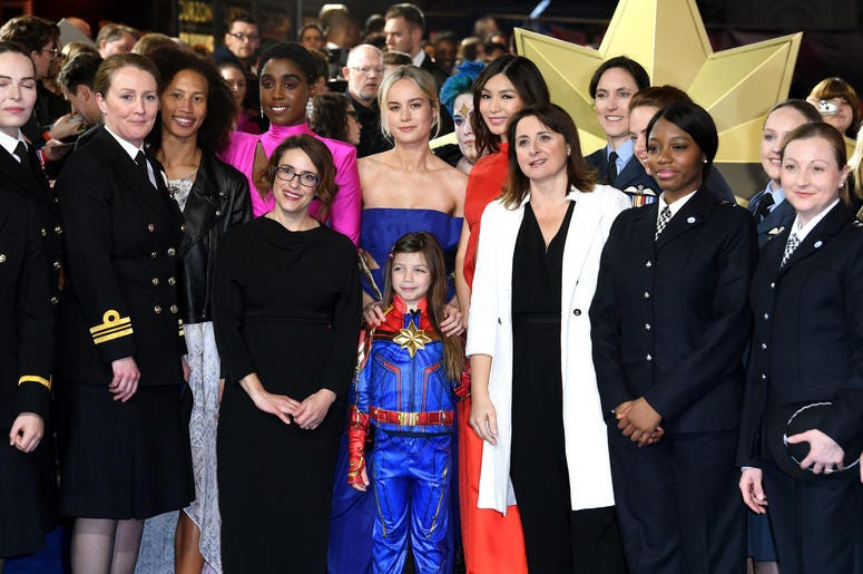 Lashana Lynch (centre left) Brie Larson (centre) Gemma Chan (centre right) Anna Boden (front left) and Victoria Alonso (second right) with members of the UK Armed Forces atthe European premiere of Captain Marvel at Curzon Mayfair, London.