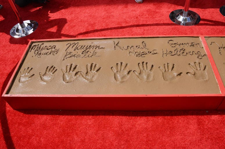 """The Cast of """"The Big Bang Theory"""" Melissa Rauch, Mayim Bialik, Kunal Nayyar and Simon Helberg's Handprints in Cement held at the TCL Chinese Theatre in Hollywood, CA on Wednesday, May 1, 2019."""