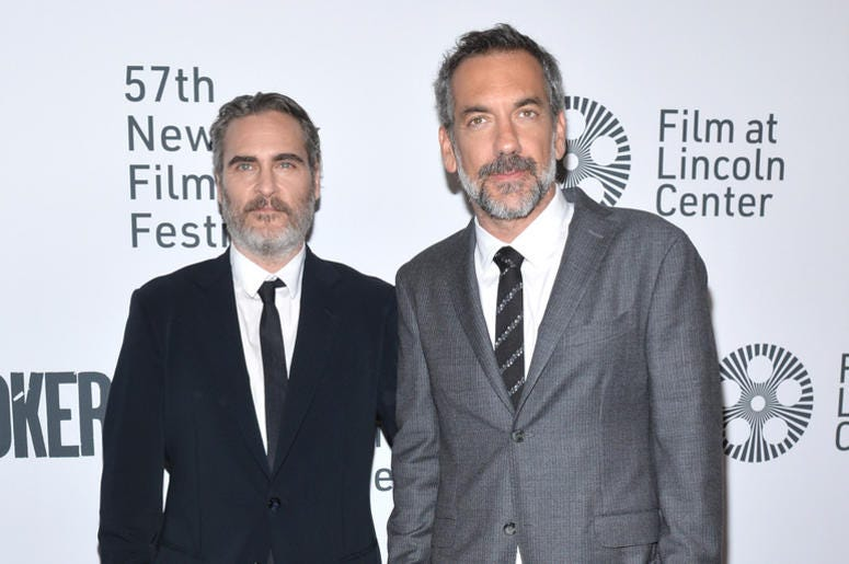 """(L-R) Actor Joaquin Phoenix and Director Todd Phillips attend the """"Joker"""" Premiere at the 57th New York Film Festival in New York, NY, October 2, 2019."""