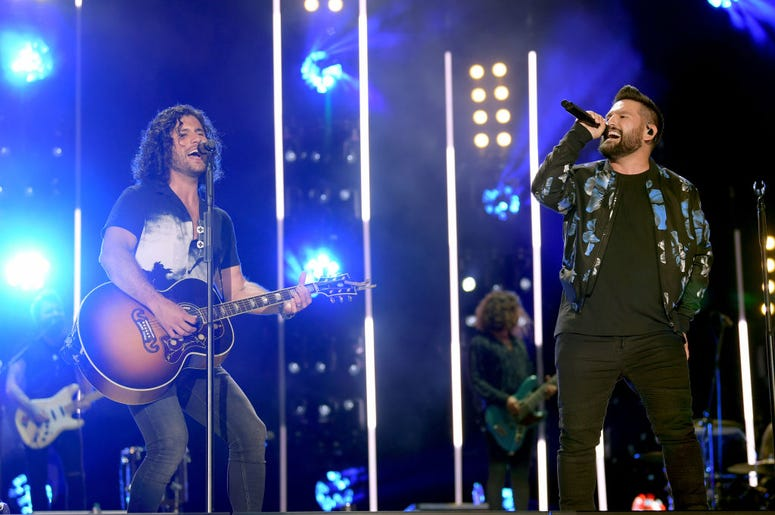 Dan Smyers and Shay Mooney of Dan + Shay perform on stage