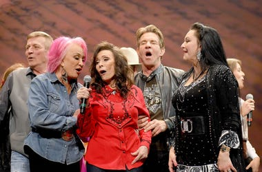 anya Tucker, Loretta Lynn, Dennis Quaid and Crystal Gayle perform onstage for Loretta Lynn: An All-Star Birthday Celebration Concert at Bridgestone Arena on April 1, 2019 in Nashville, Tennessee