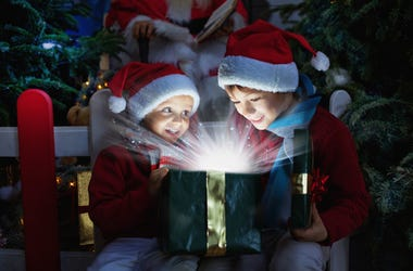 Two children opening Christmas gifts