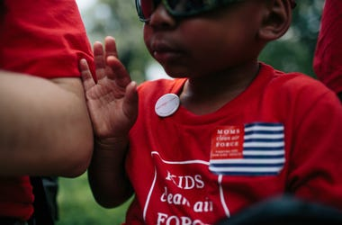 Zion Glover, 3, from Charlotte, N.C., dons a Moms partisan button as he and his mother Nakisa Glover, attend a Moms Clean Air Force rally