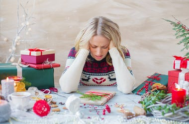 Frustrated, Stressed Woman Wrapping Christmas Presents