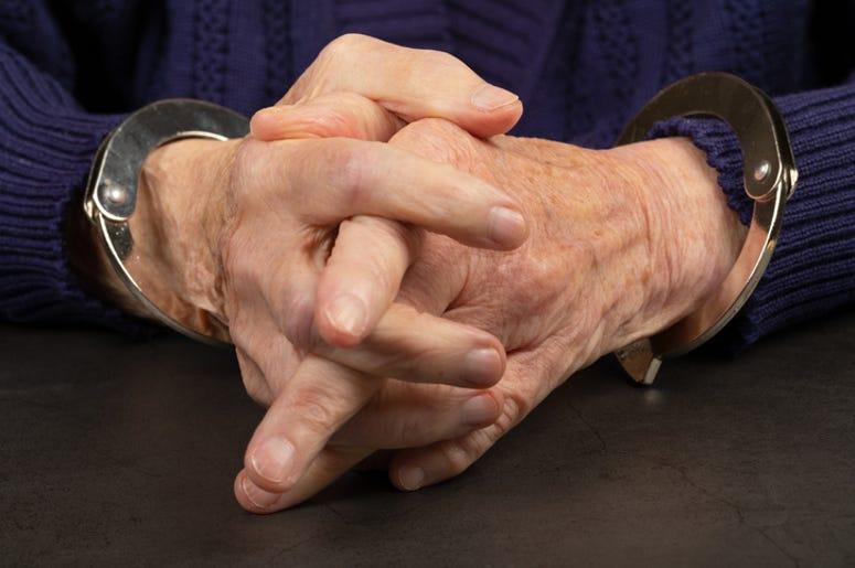 Senior Arrested In Handcuffs
