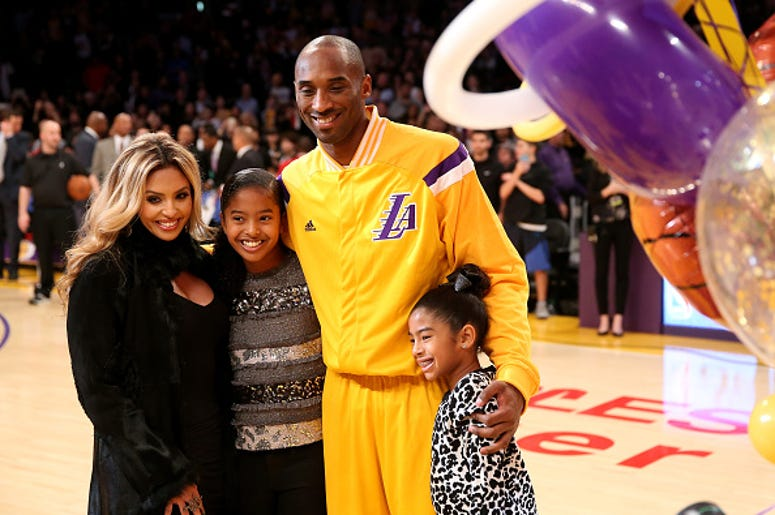 Kobe Bryant #24 of the Los Angeles Lakers poses with wife Vanessa and daughters Giana (L) and Natalia (R)