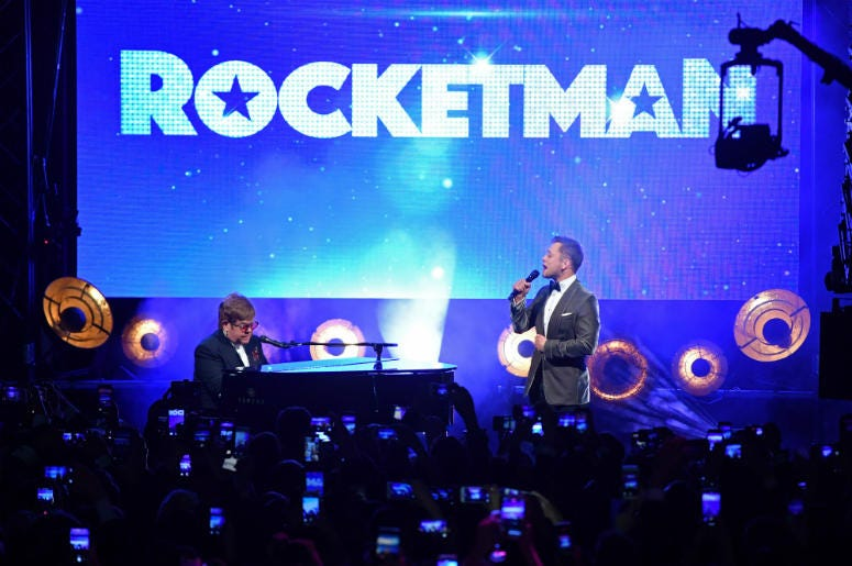 """Sir Elton John and Taron Egerton perform during the """"Rocketman"""" Gala Party during the 72nd annual Cannes Film Festival"""