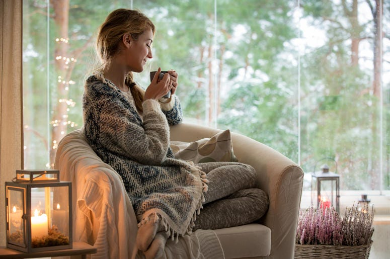 Woman relaxing with cup