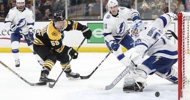 Bruins forward Noel Acciari scores against the Tampa Bay Lightning