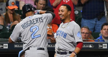 Mookie Betts and Xander Bogearts celebrate.