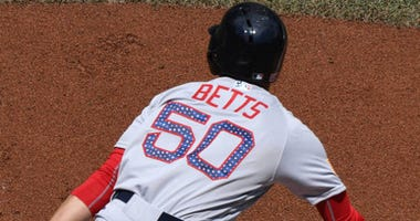 Mookie Betts of the Red Sox was off and running on Sunday against the Blue Jays.