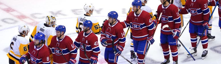 The Montreal Canadiens and Pittsburgh Penguins go through the fist-bump line after their series.