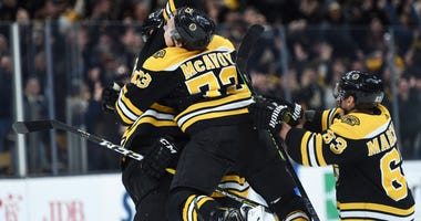 Charlie McAvoy, Zdeno Chara and Brad Marchand celebrate a Bruins goal