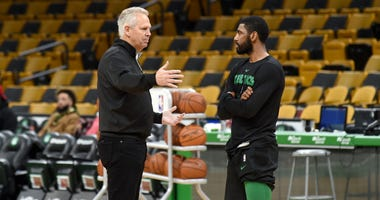 Danny Ainge and Kyrie Irving talk before a 2018-19 Celtics game