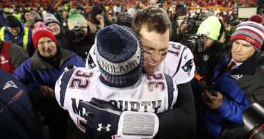 Brady hugs McCourty