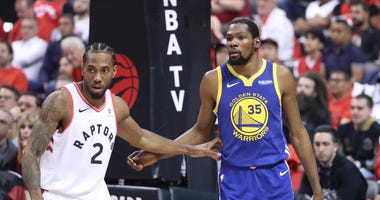 Raptors forward Kawhi Leonard and Warriors forward Kevin Durant