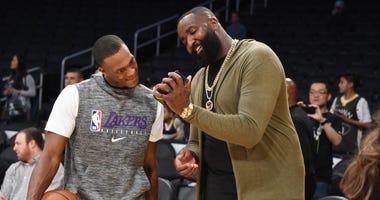Ex-Celtics teammates Kendrick Perkins and Rajon Rondo share a laugh