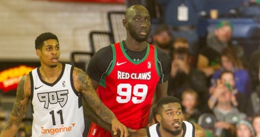 Tacko Fall battles for position against two Raptors 905 players