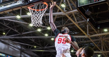 Tacko Fall throws up a shot against Raptors 905