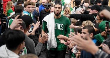Jayson Tatum walks off the court after his big night