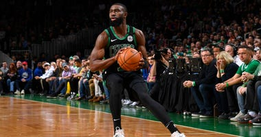 Jaylen Brown gets ready to make a move against the Sixers