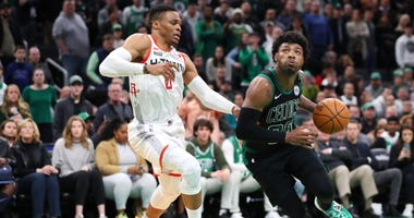Marcus Smart drives past Russell Westbrook