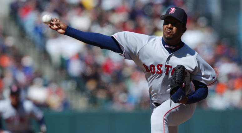 Pedro Martinez delivers a pitch for the Red Sox back in 2002