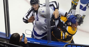 Bruins defenseman Matt Grzelcyk responds to Lightning forward Barclay Goodrow