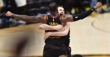 Kevin Love hugs LeBron James