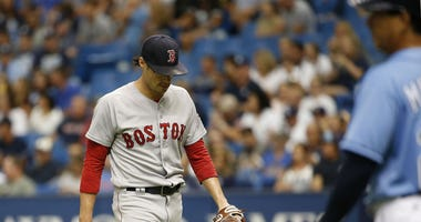 Joe Kelly walks off in disappointment after allowing go-ahead homer to Rays.