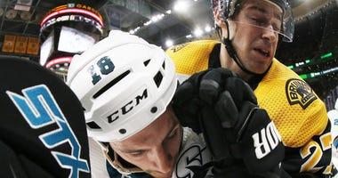 Bruins defenseman John Moore hits Sharks forward Micheal Haley