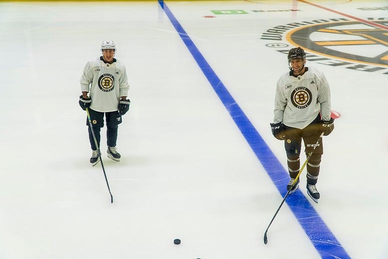 Patrice Bergeron, Brad Marchand (Photo courtesy Boston Bruins)