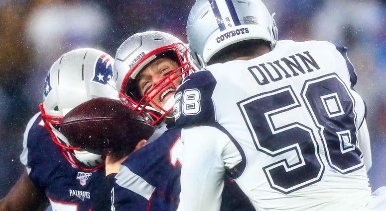 Robert Quinn hits Tom Brady