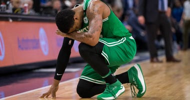 Marcus Smart prays after Jaylen Brown's fall.
