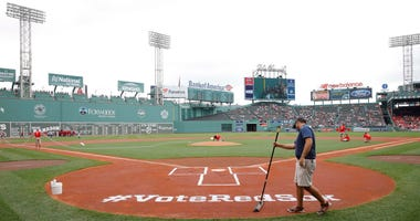 Jun 24, 2018; Boston, MA, USA; Fenway Park grounds crew prep a sign at home play for MLB Allstar voting before the start of the game against the Seattle Mariners.