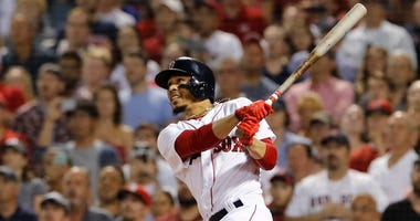 Jul 12, 2018; Boston, MA, USA; Boston Red Sox right fielder Mookie Betts (50) hits a grand slam against the Toronto Blue Jays in the fourth inning at Fenway Park.