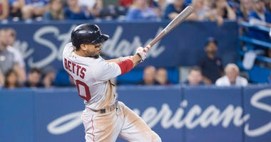 Mookie Betts hitting a home run in the ninth inning completing his first cycle against the Toronto Blue Jays