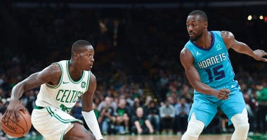 Celtics guard Terry Rozier and Hornets guard Kemba Walker