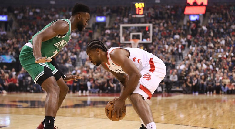 Celtics forward Jaylen Brown and Raptors forward Kawhi Leonard