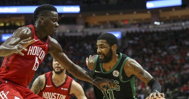 Houston Rockets center Clint Capela and Boston Celtics Kyrie Irving