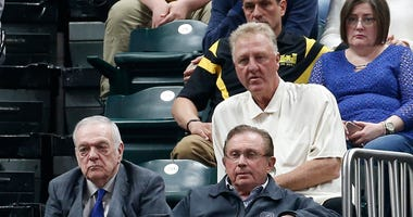 Larry Bird watches a Celtics-Pacers playoff game