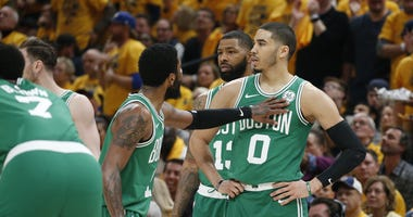 Celtics guard Kyrie Irving and forward Jayson Tatum