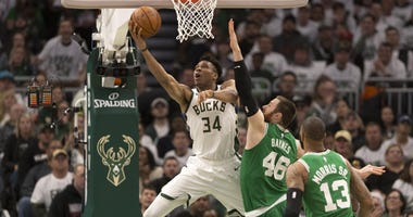 Milwaukee Bucks forward Giannis Antetokounmpo and Boston Celtics center Aron Baynes