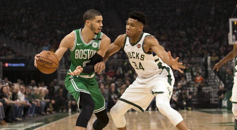 Boston Celtics forward Jayson Tatum and Milwaukee Bucks forward Giannis Antetokounmpo
