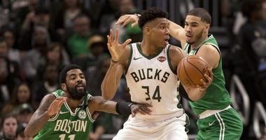 Milwaukee Bucks forward Giannis Antetokounmpo and Celtics guard Kyrie irving