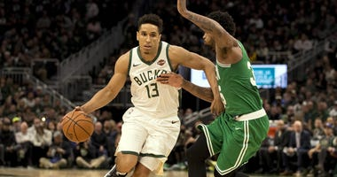 Bucks guard Malcolm Brogdon and Celtics guard Marcus Smart